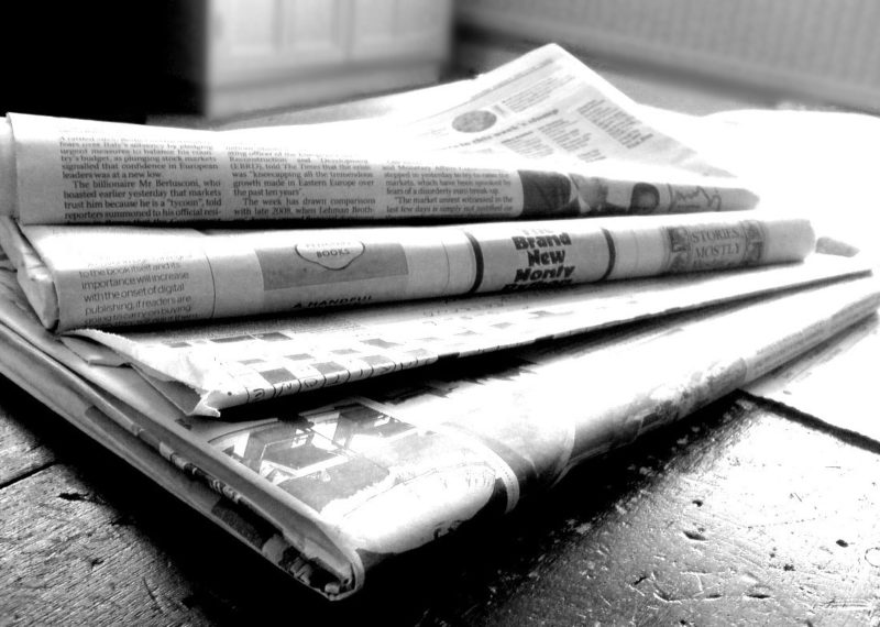 paper news in a table, black and white