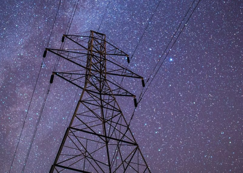 electrical tower at night with stars in the sky