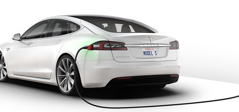 charging a white Tesla Car, white background