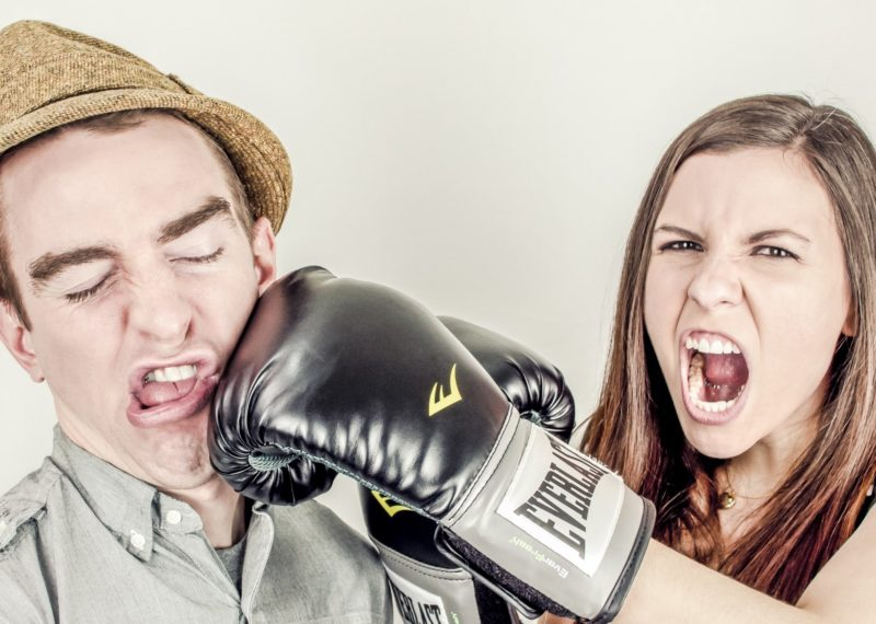 girl hitting boy with box gloves