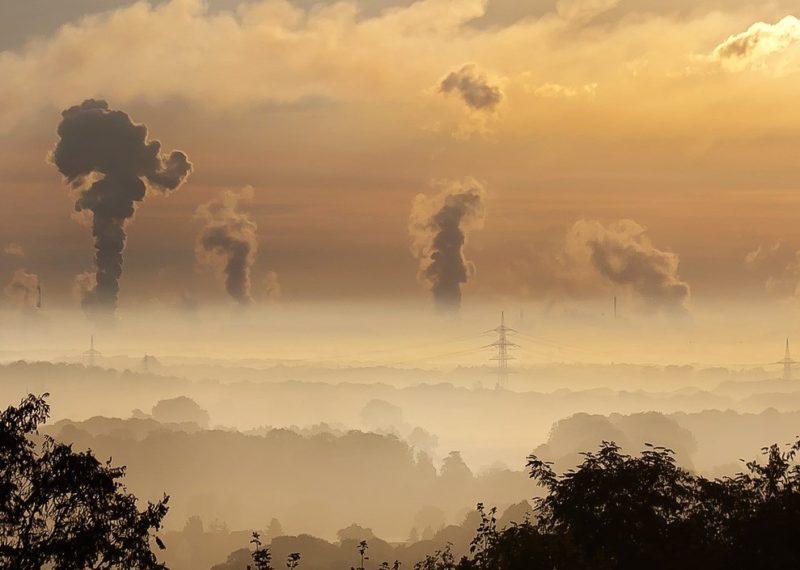 skyline of smokestacks at dusk