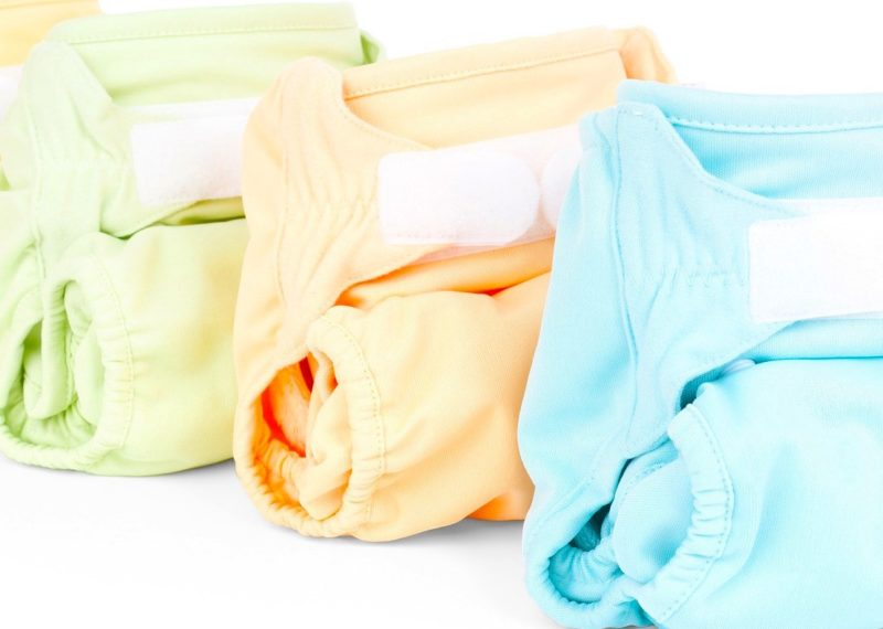 light blue, orange, green and yellow Diapers
