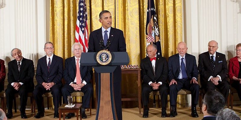 President Barack Obama speaks at the National Medal of Technology and Innovation awards, November 17, 2010. National Medal of Science recipient Warren Washington sits to his left.
