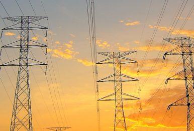 medium voltage towers sunset