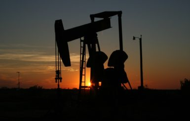 oil rig silhouette with sunset background