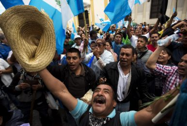 guatemalans celebrating with flags