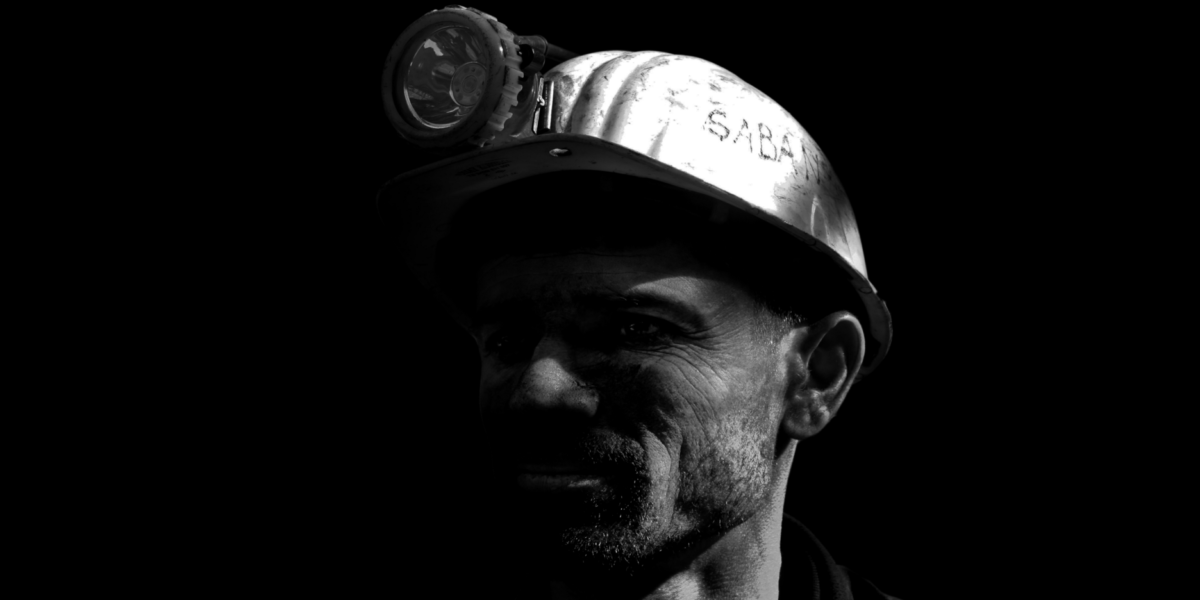face miner black and white with helmet