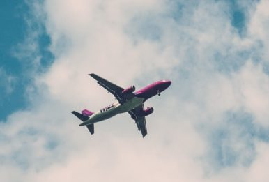 airplane purple and white in the cluoudy day
