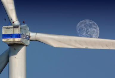 wind elices with the moon in the background
