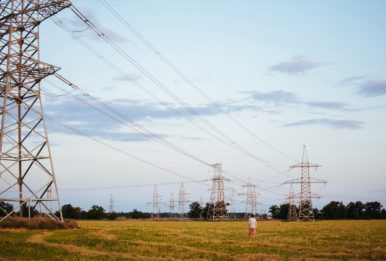 electrical towers with a guy walking in the camp