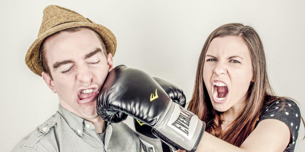 girl hitting boy with box gloves