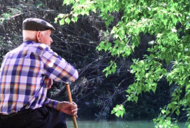 old man watching the river