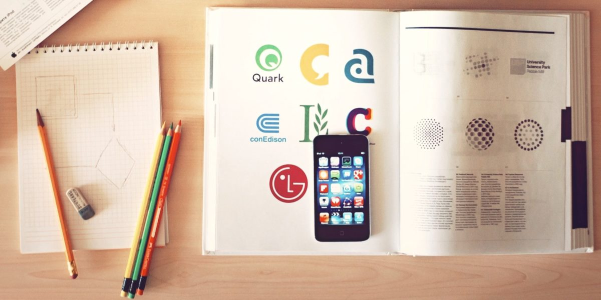 book, notebook, crayons, pencil and cellphone