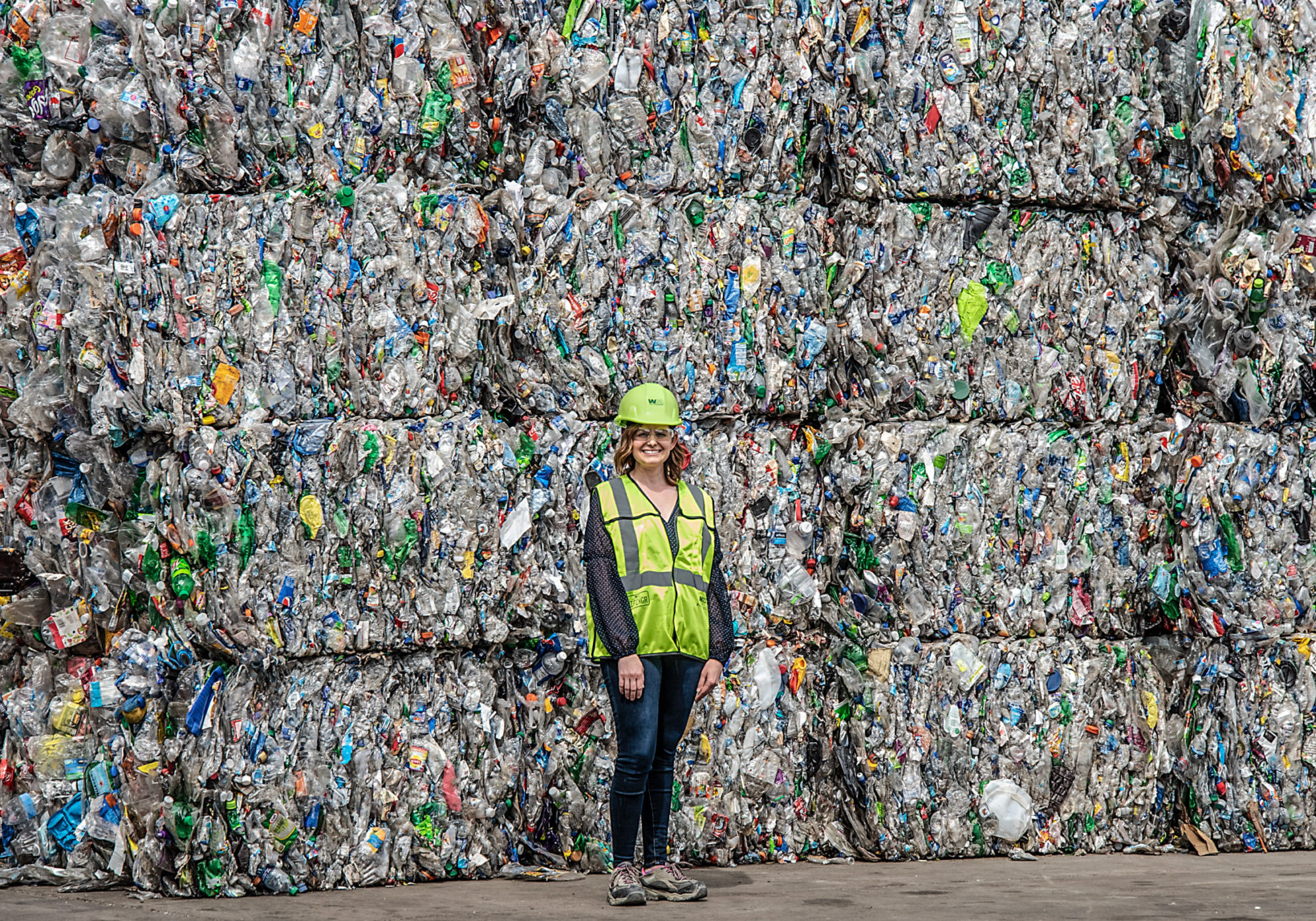 Erika Deyarmin-Young, spokesperson for Waste Management, stands with bales of plastic garbage at Greenstar Recycling on Neville Island in the Ohio river, around 20 miles south of Shell's cracker plant. CREDIT: Teake Zuidema/Nexus Media News