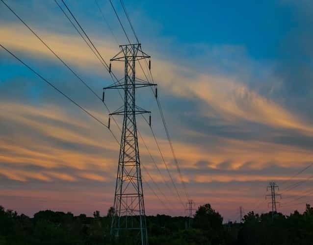 view of grid power lines during sunset