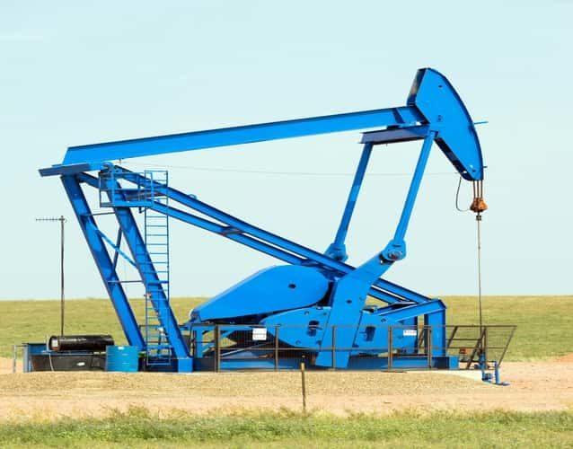 oil blue derrick pump in a field