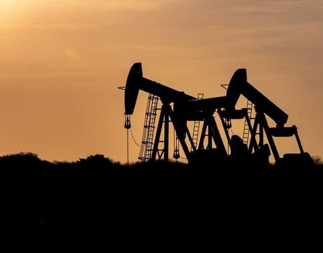 oil derrick pump silhouette photo taken during sunset