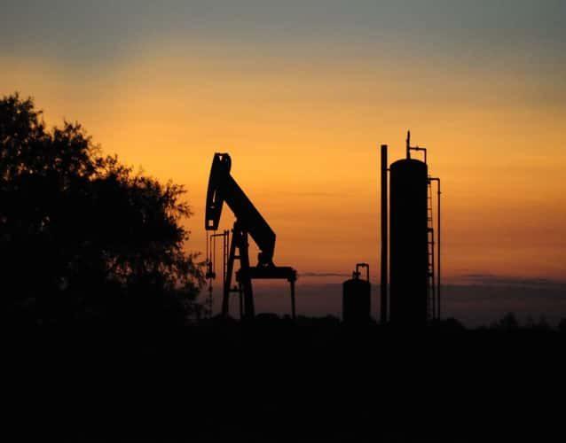 oil derrick pump and tank photo taken during sunset