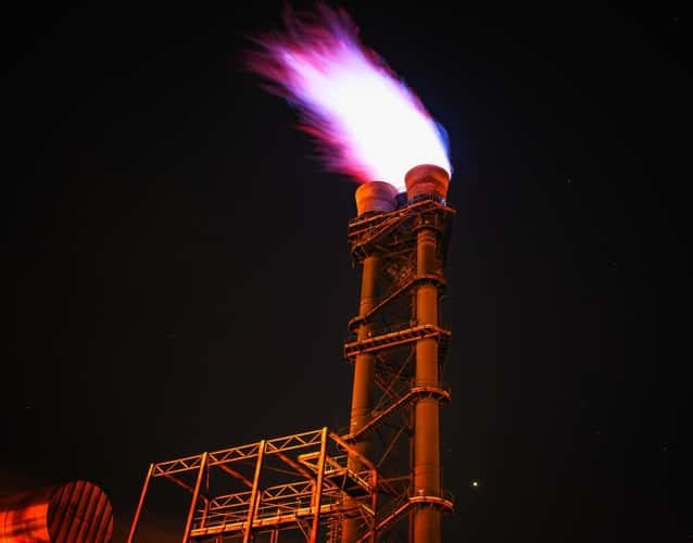 refinery flare at night