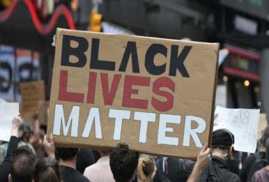 big black lives matter cardboard sign