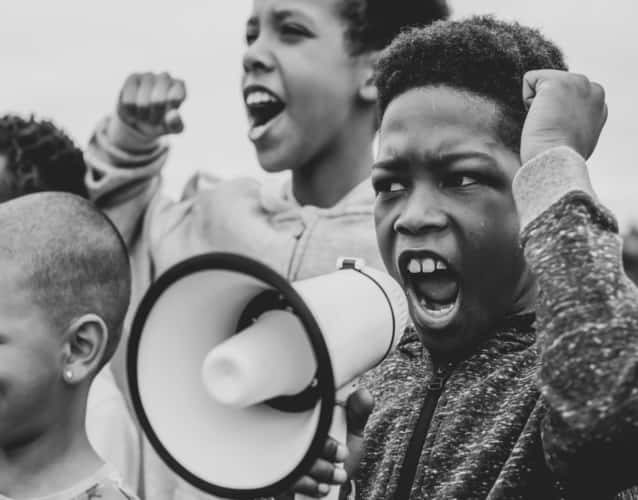 black kid holding a bullhorn during protest