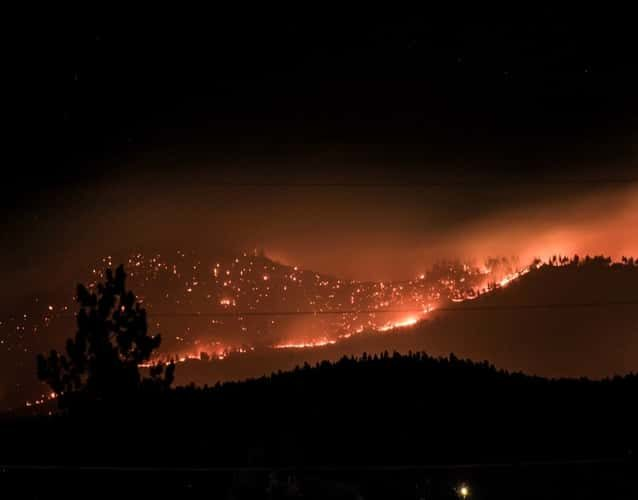wildfire on hills during the night