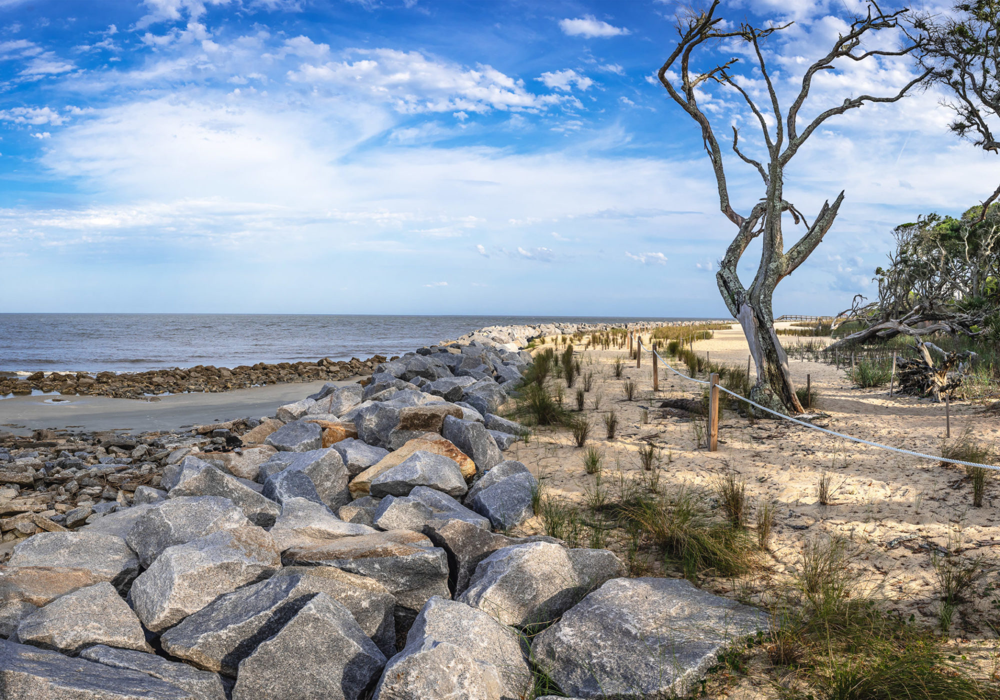 Officials have erected a small, rocky seawall to preserve this beach, just south of Driftwood beach, and on the northeastern side Jekyll Island. Credit: Teake Zuidema for Nexus Media News