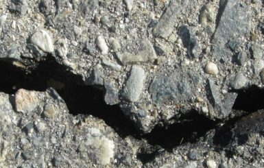 A crack in a road. Source: Pixabay