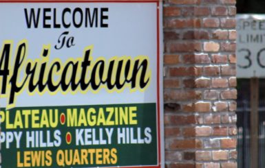 A sign welcoming visitors to Africatown. Source: Amy Walker
