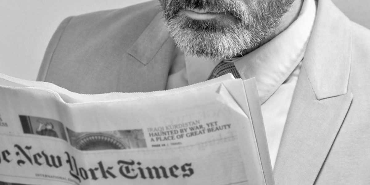 A man reading The New York Times. Source: Pexels