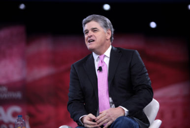 Sean Hannity sitting at CPAC