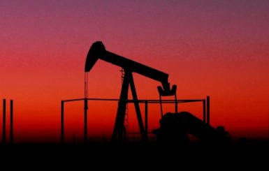 oil rig silhouette with red sky background