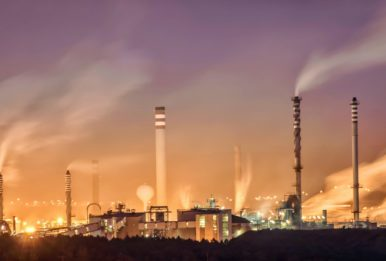 smoke stacks at dusk