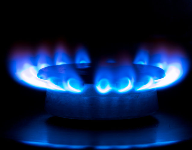 blue flames from a gas stove in the dark