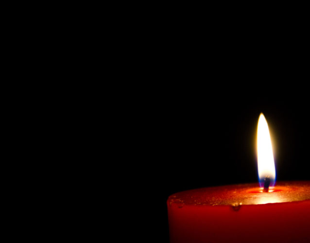 a candle lighting the darkness